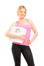 Blond Smiling Female Athlete Holding A Weight Scale Stock Photos - 28334583