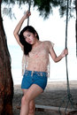 Portrait Of Pretty Asian Woman Standing On A Swing . Royalty Free Stock Photography - 28341827