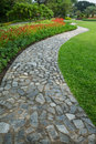 The Stone Block Walk Path In The Park With Green Grass And Flowe Royalty Free Stock Images - 28342419