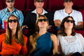 Young People Strained Watching 3d Movie At Movie Theater Royalty Free Stock Photos - 28366458