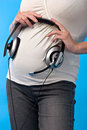 Pregnant Woman With Headphones Stock Photography - 2841002