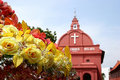 Yellow Roses And Red Church Stock Photo - 2848420