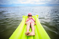 Little Girl Laying On Tube Swimming Stock Photos - 28409183