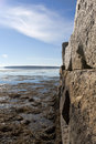 Rock Wall With Ocean In Background. Royalty Free Stock Images - 28411949