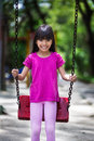 Happy Asian Little Girl Smiling On Swing Stock Photos - 28415223