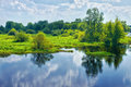 Spring Landscape With River And Clouds On The Blue Sky Royalty Free Stock Image - 28419106