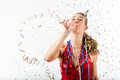 Woman Celebrating Birthday With Streamer And Party Hat Stock Image - 28438711