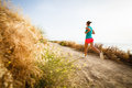 Young Woman On Her Evening Jog Along The Seacoast Royalty Free Stock Photo - 28442235