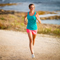 Young Woman On Her Evening Jog Along The Seacoast Royalty Free Stock Images - 28442239