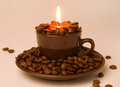 Burning Candle And Coffee Beans Royalty Free Stock Image - 28463486