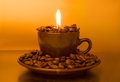 Burning Candle And Coffee Beans Stock Photos - 28463543