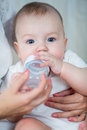 Mother Feeding His Baby Boy By Milk From Bottle Stock Image - 28465561