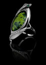 Rings With Diamonds And Green Gem Royalty Free Stock Images - 28472089