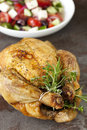 Roasted Chicken With Herbs And Greek Salad Stock Photo - 28487840