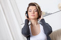 Pretty Woman In Headphones Listens To Music Stock Images - 28494704