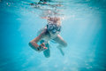 Boy Swimming Under Water Royalty Free Stock Photography - 28495757