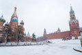 St Basil Temple And Spasskaya Tower Of Kremlin During Snowstorm Royalty Free Stock Photography - 28497987