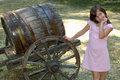 Cute Girl Next To Barrel Stock Image - 2852701