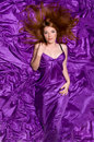 Girl With Long Hair On Purple Fabric Royalty Free Stock Images - 28504109