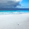 White Rock In A White Beach Under Blue Cloudy Sky Royalty Free Stock Photos - 28518588