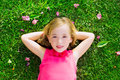 Blond Kid Girl Lying On Garden Grass Smiling Aerial View Royalty Free Stock Photo - 28521715