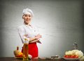 Asian Cook Woman Crossed Her Arms Royalty Free Stock Photography - 28536397