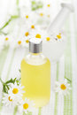 Essential Oil And Camomile Flowers Stock Photography - 28545232