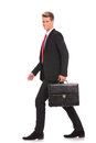 Business Man Holding Brief Case And Walking Stock Photo - 28551220