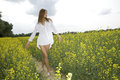 Brunette Woman In A Yellow Flowers Field Stock Photos - 28551553