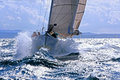 Sailboat Breaking Through The Splashing Wave Royalty Free Stock Image - 28552716