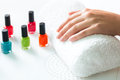 Woman In Nail Salon Receiving Manicure Royalty Free Stock Photography - 28557757