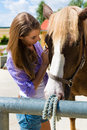 Young Woman In The Stable With Horse At Sunshine Stock Photos - 28557783