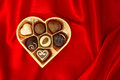 Chocolate Pralines In Golden Heart Shape Box Stock Photography - 28565812
