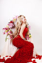 Beautiful Fashion Girl With Red Makeup And Roses. Royalty Free Stock Images - 28567629