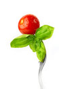 Fork With Fresh Tomato And Basil Stock Image - 28579001