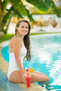 Smiling Young Woman Sitting On Pool Edge Royalty Free Stock Images - 28610299