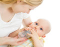 Mother Feeding Her Baby Boy Infant From Bottle Stock Photo - 28619970