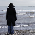 Lonely Person On A Beach Royalty Free Stock Photo - 28628355