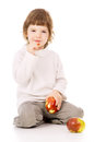 The Little Girl Leads A Healthy Way Of Life, And Eat Apples Royalty Free Stock Photography - 28635637
