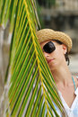 Woman In Sunglasses Near Palm Tree Royalty Free Stock Photography - 28646427
