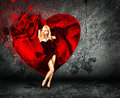 Woman With Splashing Heart On Dark Background Stock Photo - 28666440