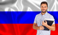 Male Student Of Languages ​​on Russian Flag Stock Image - 28667331