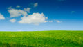 Green Hill And Blue Sky Stock Images - 28668094