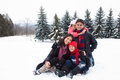East Indian Family Playing In The Snow Royalty Free Stock Photos - 28671938