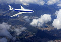 Airplane Above Clouds Royalty Free Stock Photo - 28727965