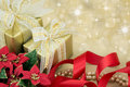 Gold Wrapped Presents With Red Ribbon And Flowers Stock Photography - 28751272