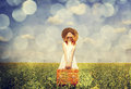 Redhead Enchantress With Suitcase At Spring Rapeseed Field. Royalty Free Stock Photo - 28759415