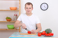 Man Cutting Tomato In The Kitchen Stock Image - 28802111