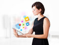 Young Woman Looking At Modern Tablet With Colourful Icons Stock Images - 28805234