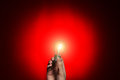 Light Bulb In Hand On Red Background Royalty Free Stock Photos - 28811538